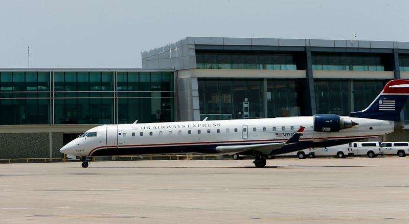 The inaugural aircraft ushering in non-stop American Airlines service to Charlotte to the  Tulsa International Airport gate Wednesday.