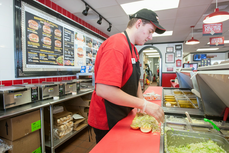 Brad Eckhart makes a sandwich and Firehouse Subs in Edmond, OK.