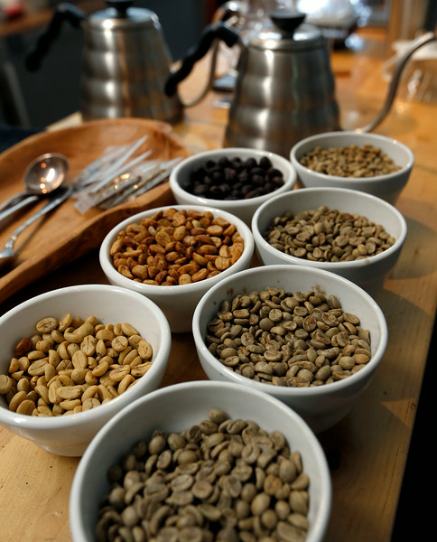 A variety of coffee beans on display at Topecca Coffee's  downtown Tulsa factory.
