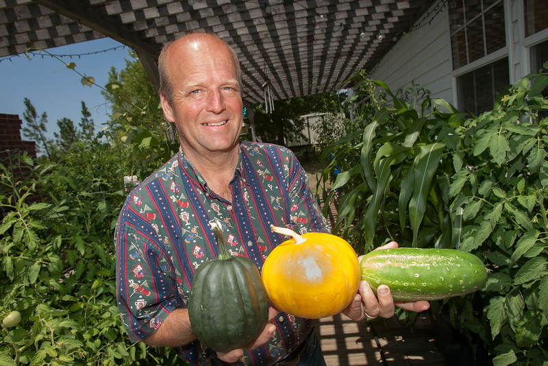 Larry Pierce with vegitable grown in his Garden Anywhere Boxes.
