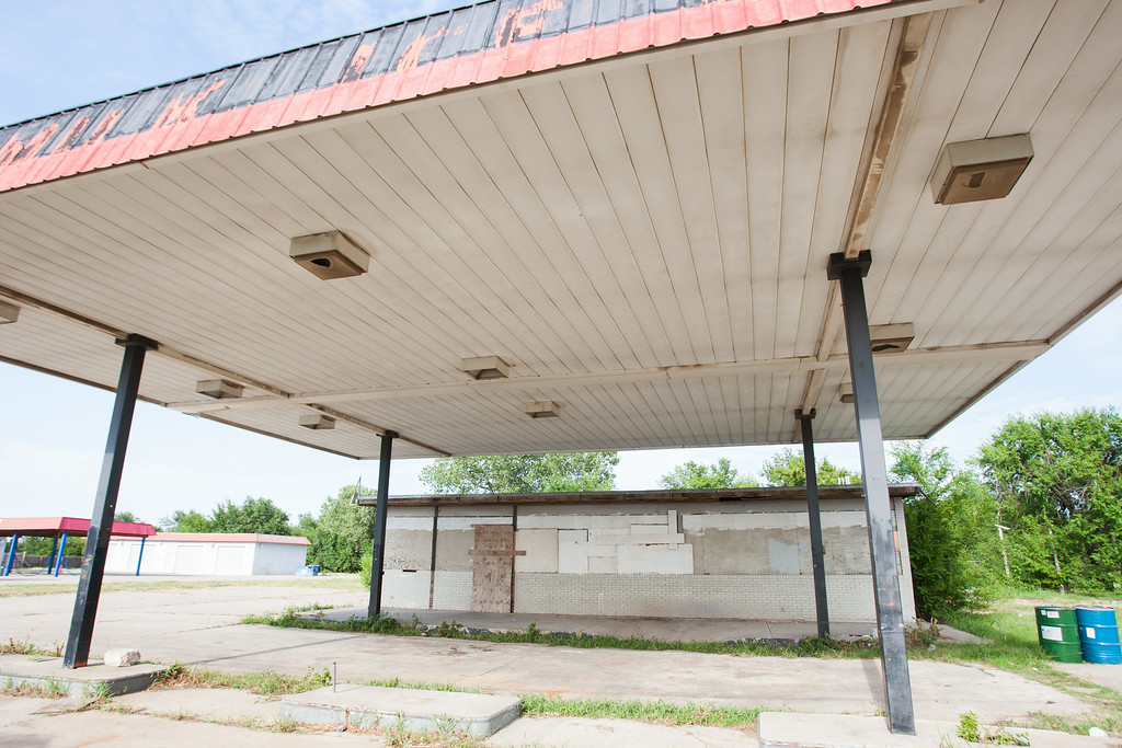 A boarded up gas station at NE 23rd and Martin Luther King in Oklahoma City, OK.