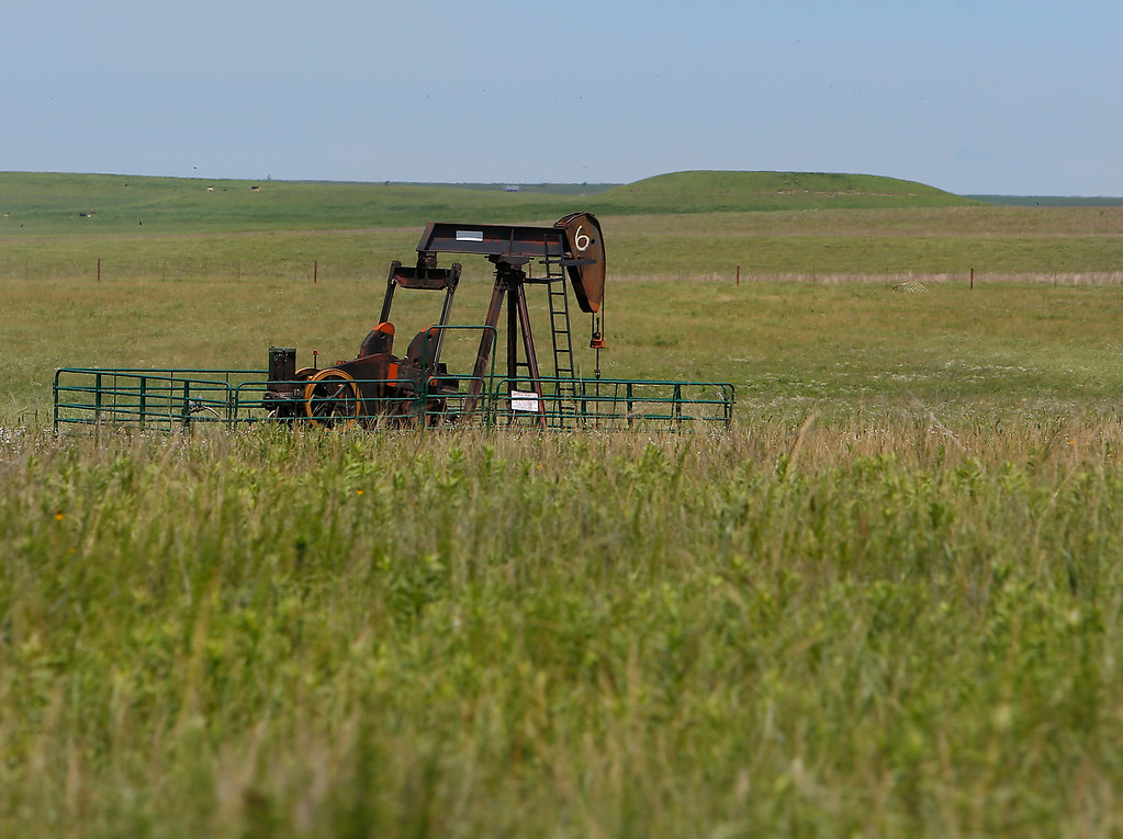 A pump jack in Osage county.<br /> <br /> oil equipment grassland tall grass prarie