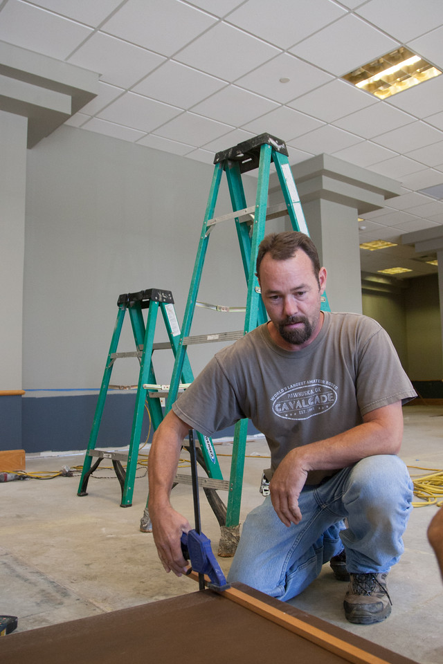 Greg Dod preparing a cabnit surface at the New Oklahoma City University law building in downtown Oklahoma City, OK.