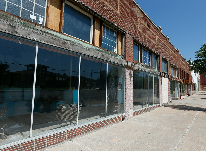 The old Sweenys hardware store in the Whittier Square Shopping Center and other storefronts sit vacant.