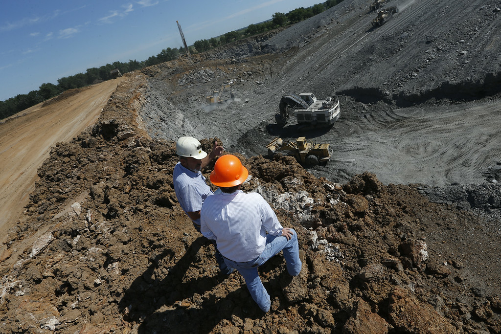 Clay Hartley, President of Phoenix Coal and Jim Brakefield, President of Brakefield equipment, observe operations at a coal strip mine East of Nowata.