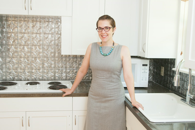 Jennifer Thurman, Executive Director of Rebuild Together, in a remodeled home that had previously been foreclosed.