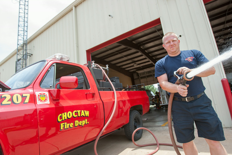 Kerry Williams, with the Choctaw Fire Department, checks the water pump on a recently converted rural fire truck. The truck was a surplus from the Forestry Department and does not yet belong to the fire department.