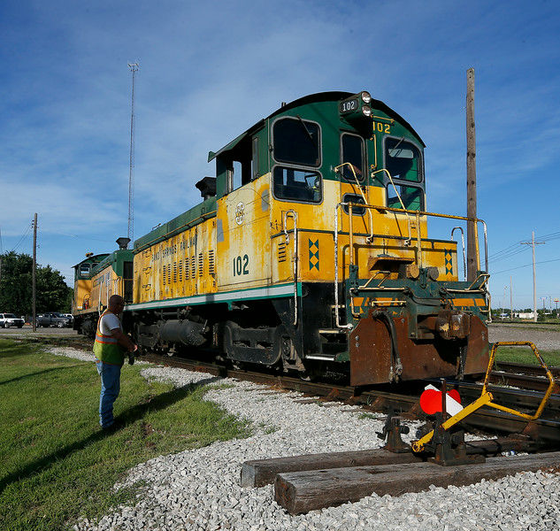 A locomotive at the Sand Springs Railway exits the yard  Tuesday.