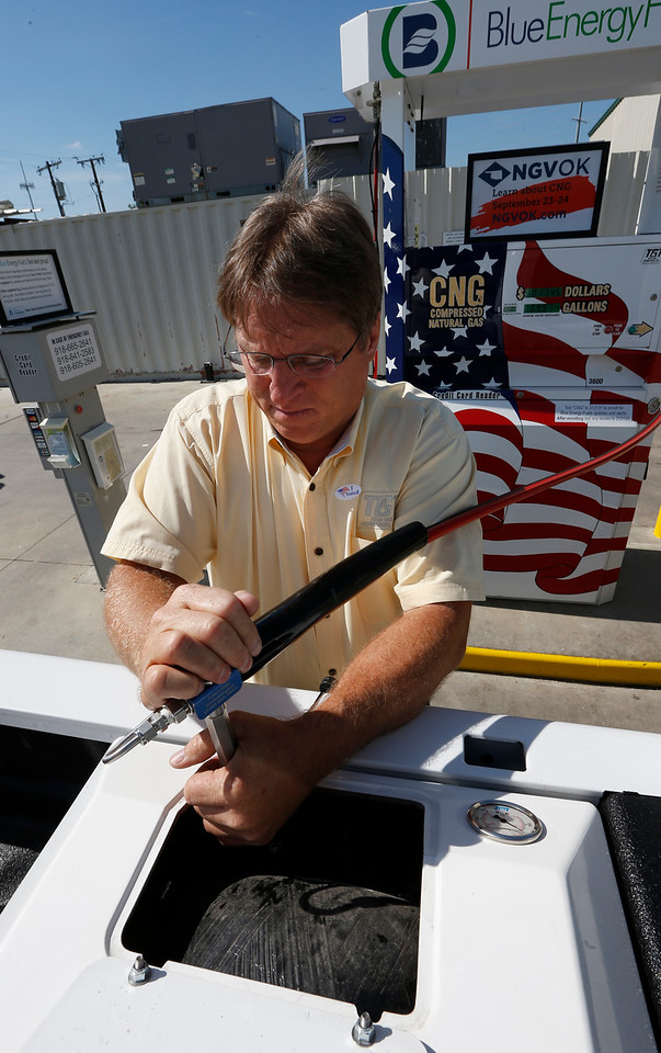 Tom Sewell fuels a CNG vehicle at the Tulsa Gas Technologies facility in East Tulsa.