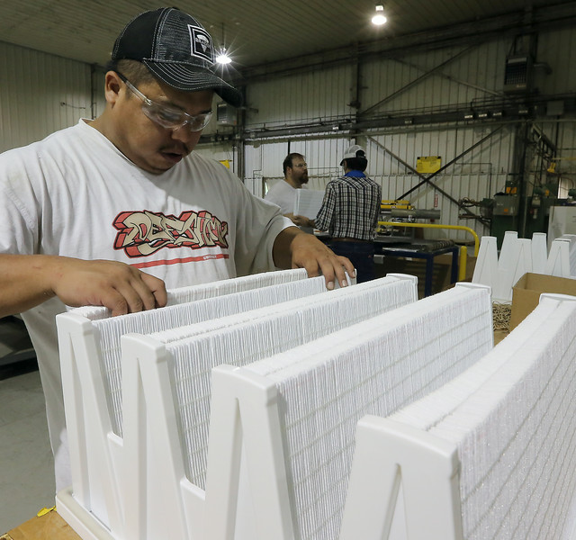 Mike Little assembles an industrial filter at the Braden Manufacturing plant in north Tulsa.
