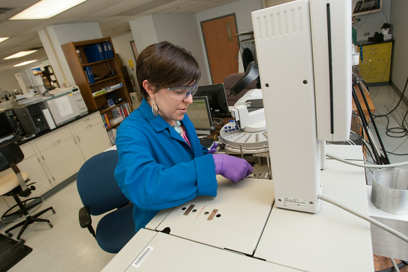 DEQ lab scientist Becky Seville works with ageing equipment that often has to be fixed or maintained by lab personel.