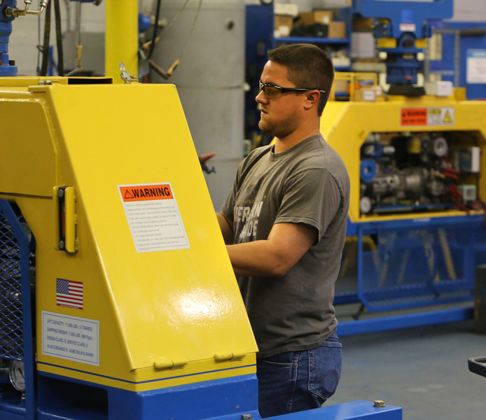 A Vacuworx employee works on the companies newest product at the companies Tulsa manufacturing plant.
