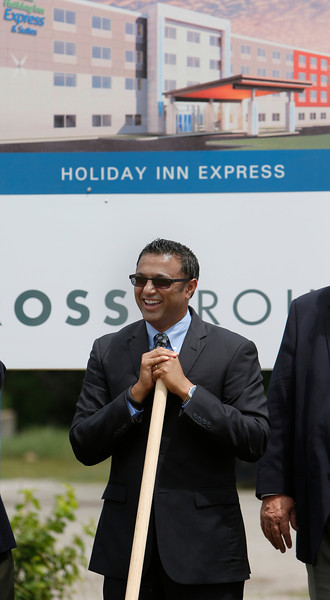 "Promise HotelsPresident and Chief Executive Paresh ""Pete"" Patel speaks to the crowd gathered at the groundbreaking ceremony of the companies Claremore Holiday Inn Express location."