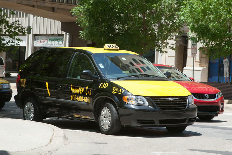 A taxi waiting for a customer in downtown Oklahoma CIty, OK.