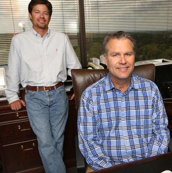 Adam Hutchinson and James Ivy of Stonebridge pause for a photo at the companies Tulsa office.