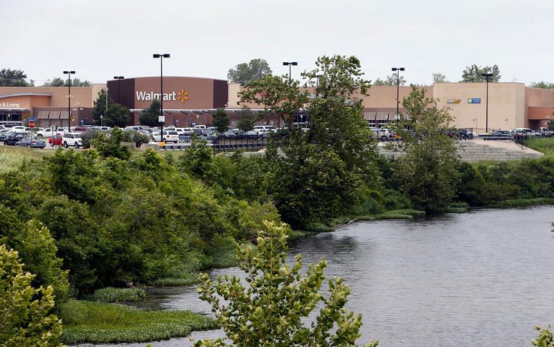 An unfinished water retention improvement near the  WalMart Supercenter at 3900 E. Hillside Drive in Broken Arrow has caused Edmonds Tapp Development to sue the cities Economic Development Authority.