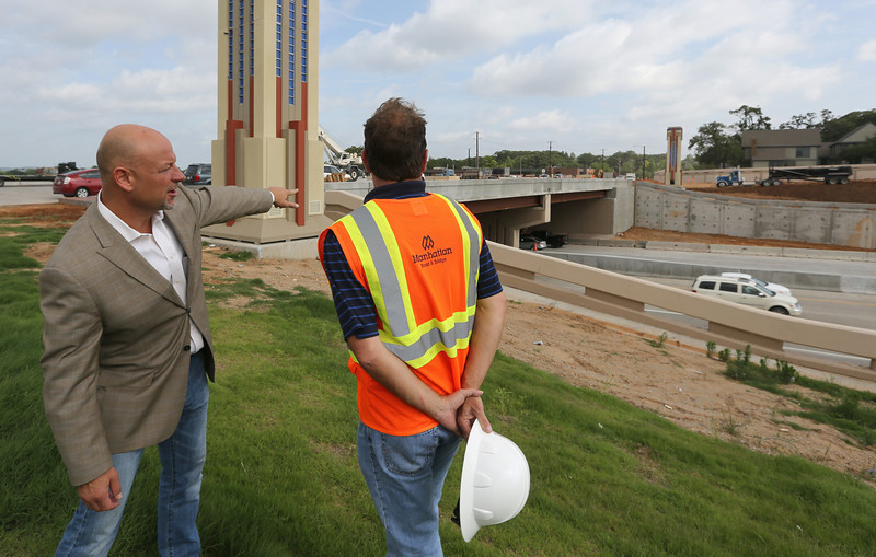 Executive Director of the Associated Contractors of Oklahoma, Robert Stem and President of Oklahoma Manhattan Construction Rich Horrocks at the nearly completed Lewis Avenue bridge spanning I-44 in Tulsa.