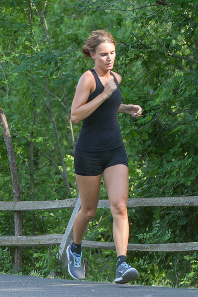 A woman running at Hafer Park in Edmond, OK.