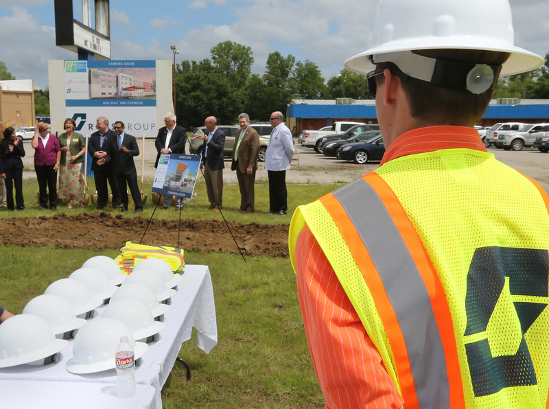 """An audience members listens at Promise Hotels President and Chief Executive Paresh """"Pete"""" Patel speaks to the crowd gathered at the groundbreaking ceremony of the companies Claremore Holiday Inn Express location."""