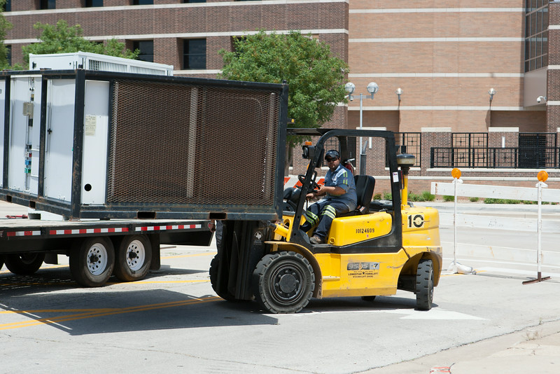 Air conditioning equipment being taken to the old Fred Jones Ford building in downtown Oklahoma City. The building will serve as a command center for OKC Fest which runs June 26-29th.