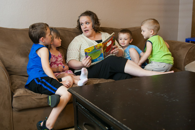 Misty Caplinger reads to some of the kids in her in home daycare located in NW Oklahoma City, OK.
