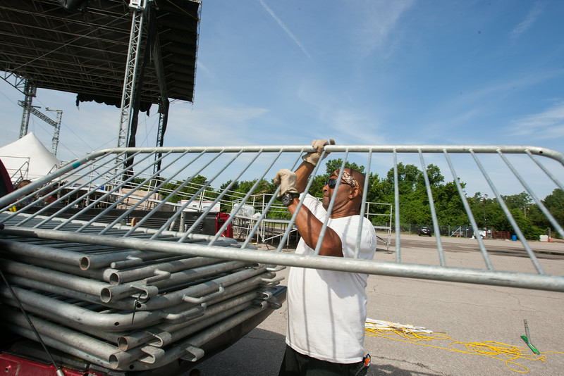 Grey McCormick loads barriers following a concert at the Oklahoma CIty Airpark.