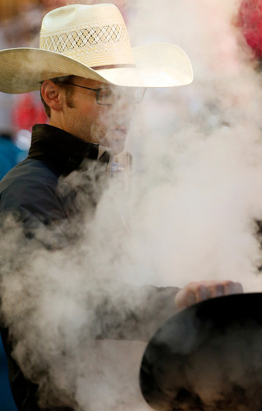 Clay Hand of Brenhan Texas 's Sombrero Brands shape a hat using steam during the Pinto World Championships in Tulsa.