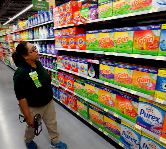 Merchandise Supervisor Ramona Bautifta checks shelves in preparation for the opening of a Wal-Mart Neighborhood market in midtown Tulsa.