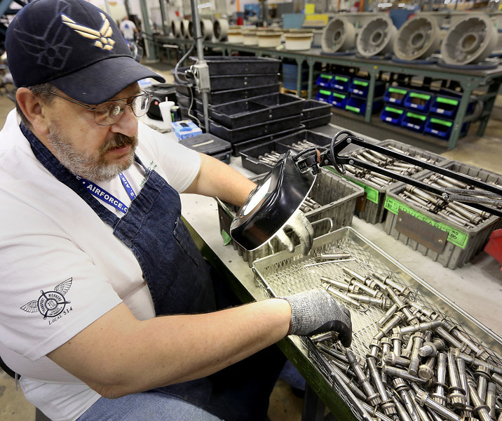 American Airlines mechanic Chip Stovall inspects brake parts at the the companies maintenance facility in Tulsa.  American Airlines Group said on Monday it reached a tentative agreement with the International Association of Machinists. The union group is key as it covers more than 11,000 mechanics, service agents, and maintenance workers.