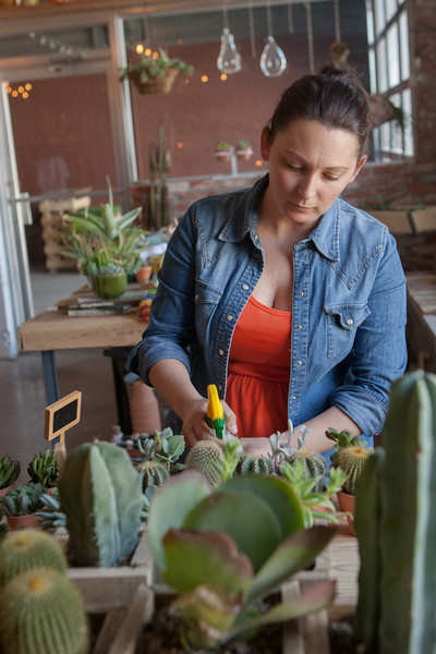 Jen Semmler waters plans at The Plant Shop located in The Hub at 7 N Lee in Oklahoma City, OK.