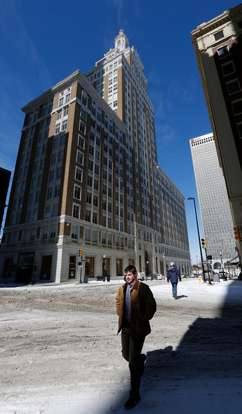 Pedestrians negotiate the snow conditions in downtown Tulsa.
