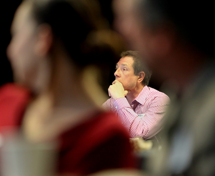 A participant listens to a presentation at the U.S. Green Building Council's first regional summit in Tulsa Friday.