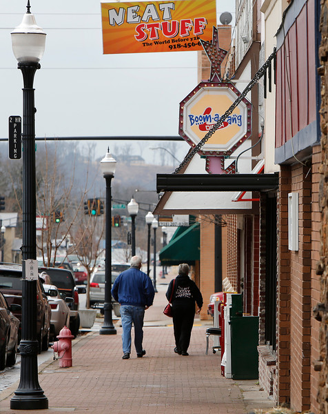 A couple leaves the Boom-a-Rang sandwich shop in downtown Tahlequah.