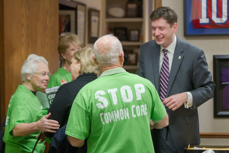 Advocates against the implimitation of Comman Core in Oklahoma held a rally at the Oklahoma State Capitol. Participants went door to door meeting with lawmakers, such as Sen David Holt (far right), and deliverd a petition to the office of the governer.