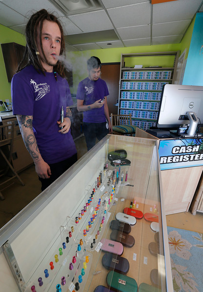 Skylar Boatman and Robbie Olivarez at the Bixby Palm Beach Vapors store.  Palm Beach Vapors expects to open three franchised locations over the next two months, with 50 targeted by the end of the year.