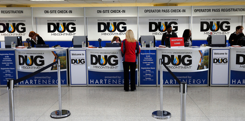 A participant at the DUG Convention in Tulsa checks in for the show.