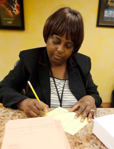 Carolyn Johnson, Precinct Offical Coordinator for the Tulsa County Election Board, works to complete paperwork needed by precinct workers Tuesdays election.