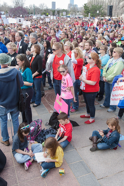 Kids coloring during a rally for education funding at the Oklahoma State Capitol.