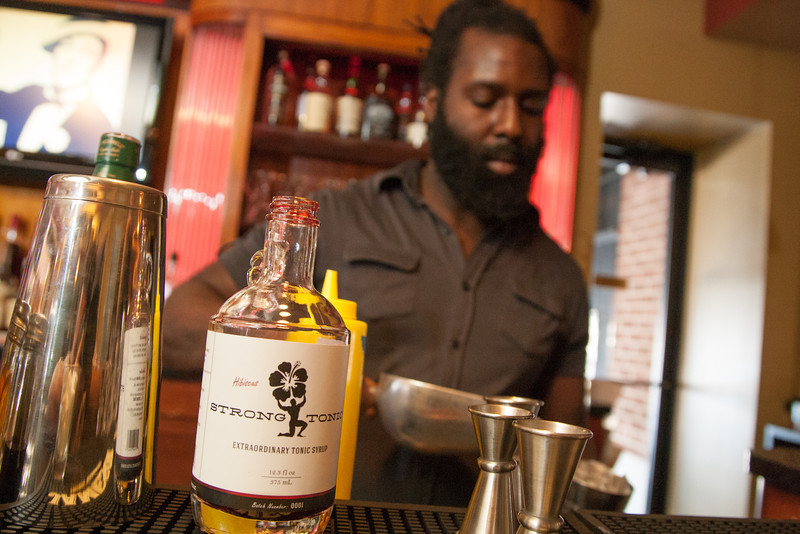 Xavier Porter mixes a cocktail using Strong Tonic's new Hibiscous tonic syrup.