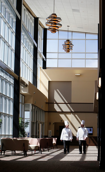 Culinary Arts students walk through the main atrium at the Tulsa Tech campus in Owasso.