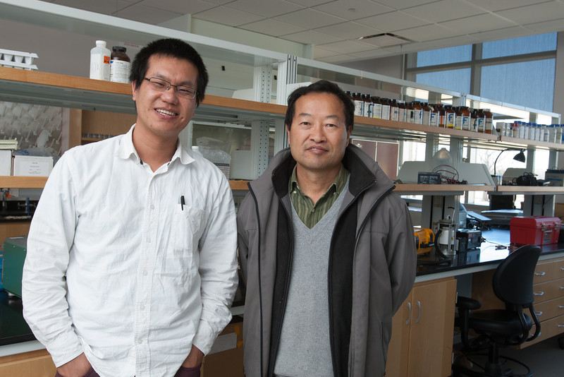 Researches Jianyang Xia and Yiqi Luo in their lab at the Stephanson Research Centerin Norman, OK.