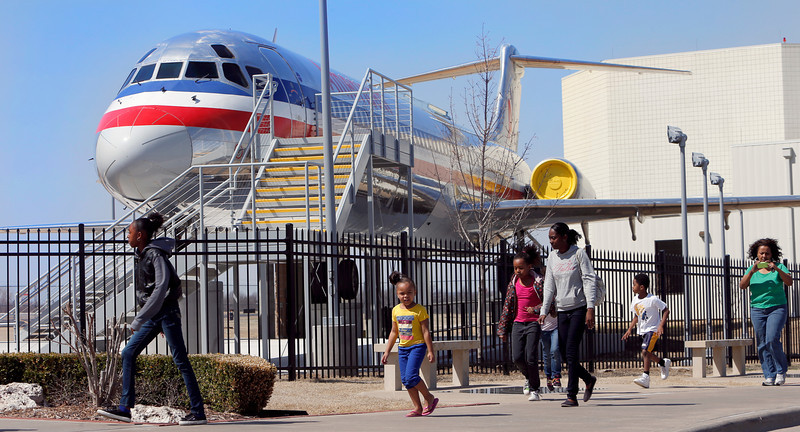 A family visits the Tulsa Air and Space Museum during spring break.