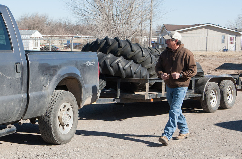 El Reno resident Brock Barber broght a trailer of used tires on the first day of the city's hazard waste siposal program.