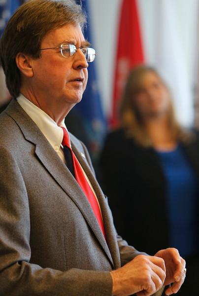 Karen Pennington Program Director at Madison Strategies looks on as Tulsa Mayr Dewey Bartlett helps announce a 250K donation to further the groups career training efforts.