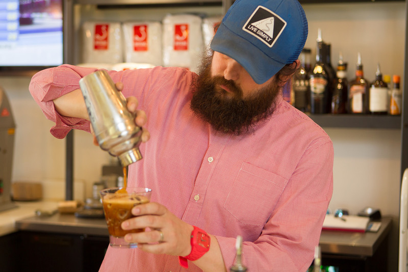 Jason Duncan mixes a Praire Russin, containing coffee and vodka, at Evoke in Edmond, OK.