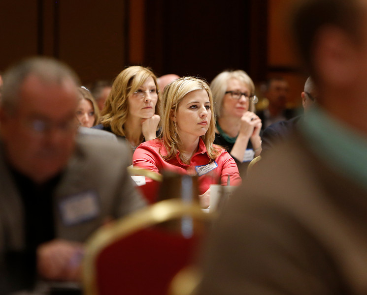 Audience members listen to Tulsa Mayor Dewey Bartlett gives the keynote speech at the Greater Tulsa Realtors conference Wednesday.