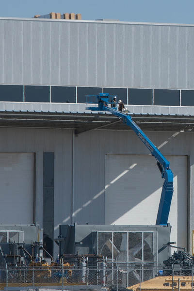 Workers working on the roof at Compass Manufacturing in Oklahoma City, OK.
