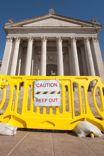 A barrier at the Oklahoma Satae Capitol in place to protect people from dangers posed by the deterating building.