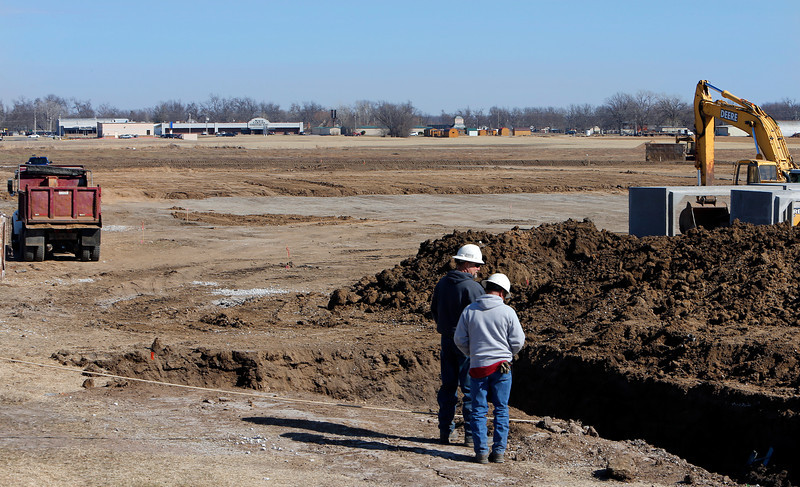 Developers are lay infrastructure on large sod farm in Bixby that is being developed into the Quail Creek housing addition.
