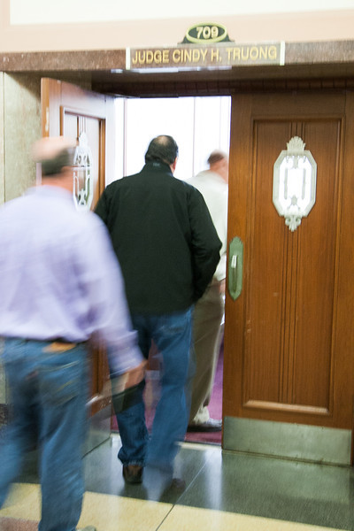 People entering a court room at the Oklahoma County Court house.